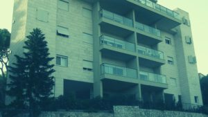 """בניין דירות עם תוספת ממ""""ד"""